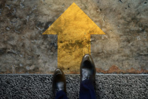 Start and Challenge Concept. a Business Man on Formal Shoes Steps to Follow a Yellow Arrow, Get Ready to Moving Forward or take a Chance to Success. Top View